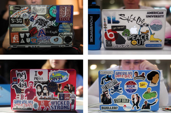 four laptops featuring an array of colorful stickers