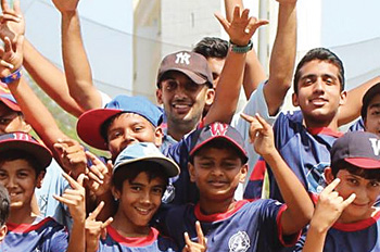 Indian children cheer on the baseball field