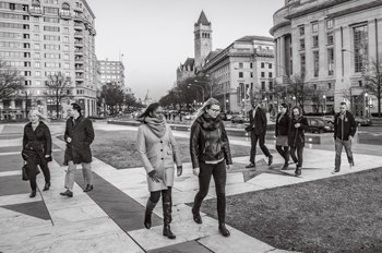au alumni and students walk across Freedom Plaza
