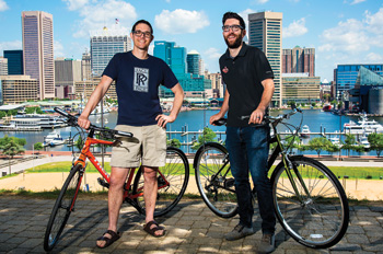 Nik and Paul near their bikes on Federal Hill in Baltimore