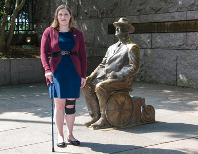 Sarah Blahovec stands next to FDR statue