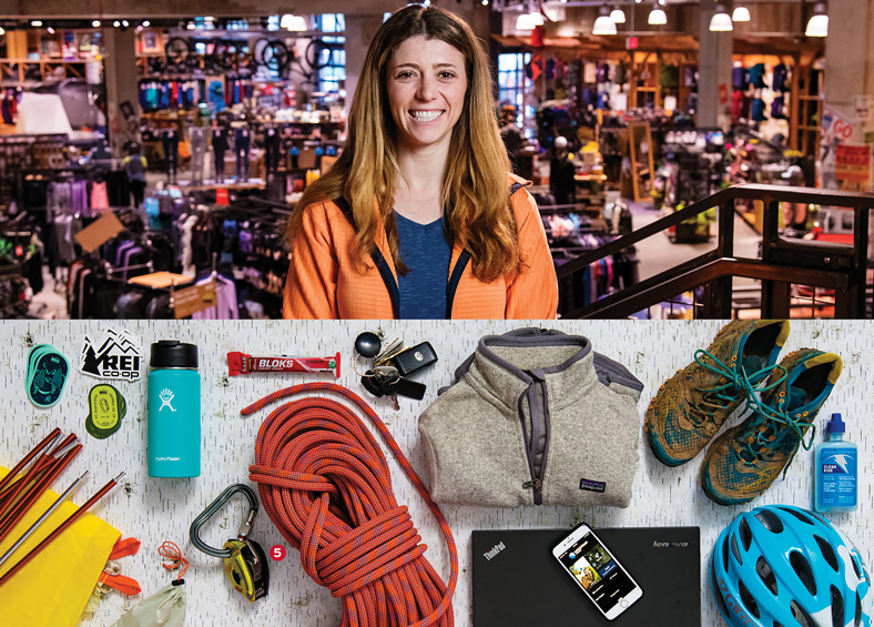 Stephanie Piperno, REI stickers, a tent, a coffee thermos, energy chews, a belaying device, climbing rope, car keys, a fleece jacket, a laptop, a smart phone, trail running shoes, bike lube, and a bike helmet