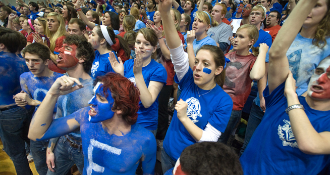 Students join the Blue Crew to cheer the AU Eagles to victory.