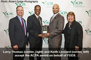 Larry Thomas (center, right) and Keith Leonard (center, left) accept the ACPA award on behalf of FDDS.