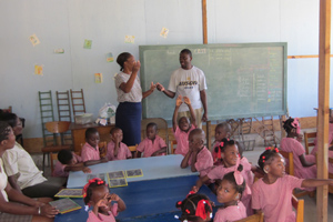 Okogo volunteered on an educational project for children with disabilities in Haiti.
