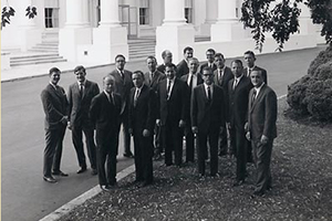 A photo of the first ever class of White House Fellows outside the White House. The Fellows met at Airlie, now given to American University.