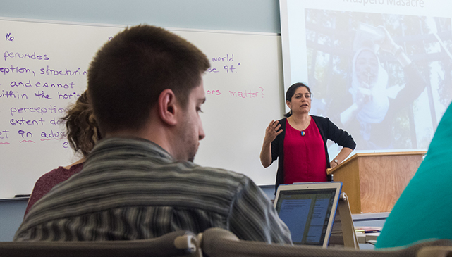 Students in a classroom with a professor