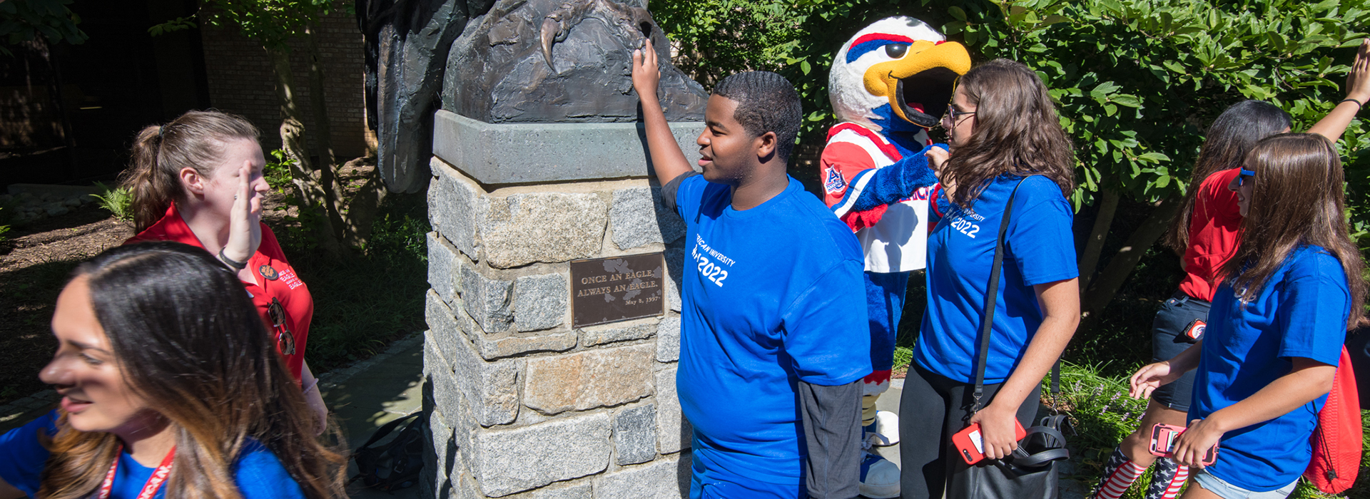 New students rub the talon of the eagle statue for good luck... during commencement, they'll do the same!