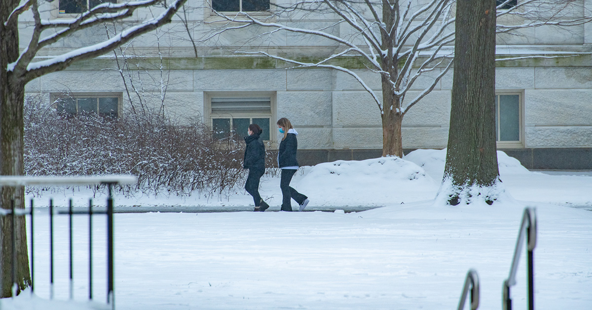 Students walk on campus after snowfall.