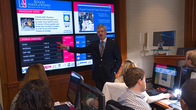 Finance professor H. Kent Baker teaches students in the Kogod Financial Lab.