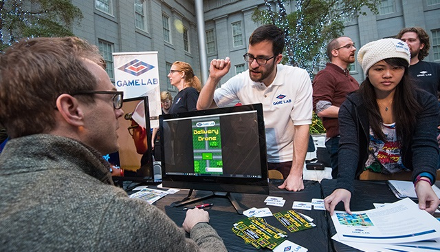 Faculty and students from American University's Game Lab at the Smithsonian's Indie-Arcade.