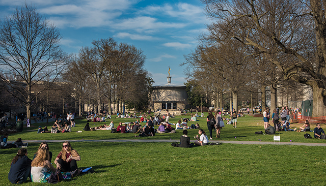 Students enjoy an early taste of spring weather on AU's main quad.