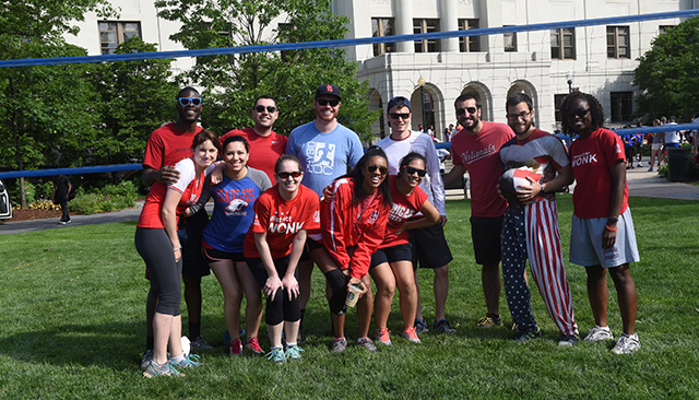 Members of AU's Office of Campus Life pose on the quad before the annual staff appreciation volleyball tournament.