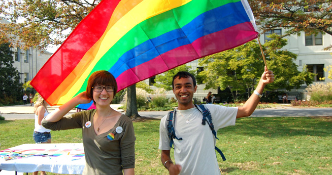 Two students with the Pride flag