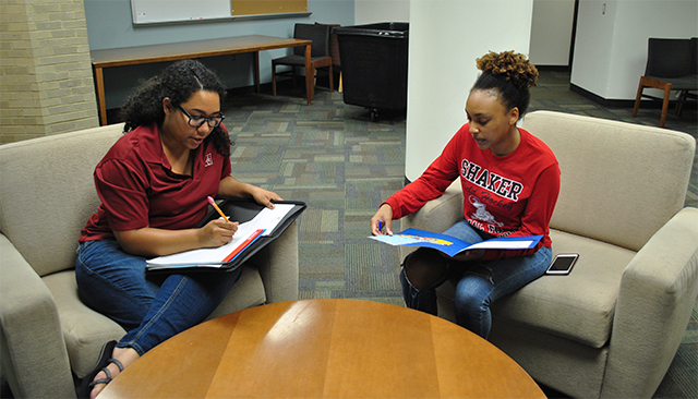 Student consulting finding off-campus housing with a staff member
