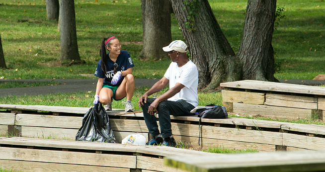 Student and staff member talking in the ampitheater