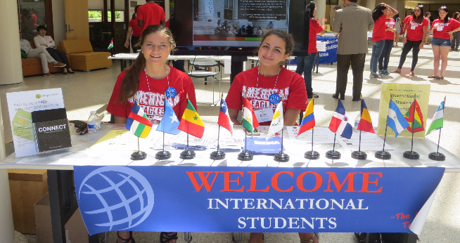 Orientation leaders at welcome desk during international orientation