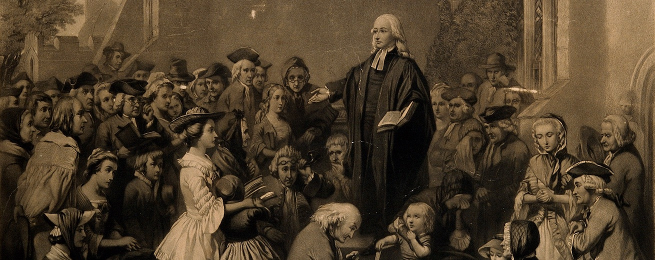 John Wesley preaching outside a church