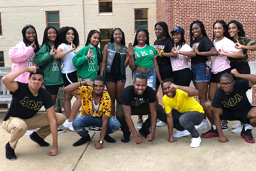 Lawrence with his Alpha Phi Alpha fraternity chapter mates and the Alpha Kappa Alpha Sorority chapter