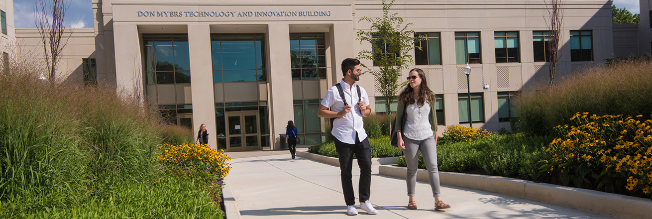 Students walking in front of the Don Myers Technology and Innovation Building