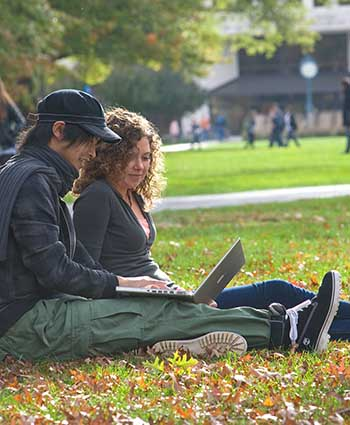 American University students relax on the quad in Autumn
