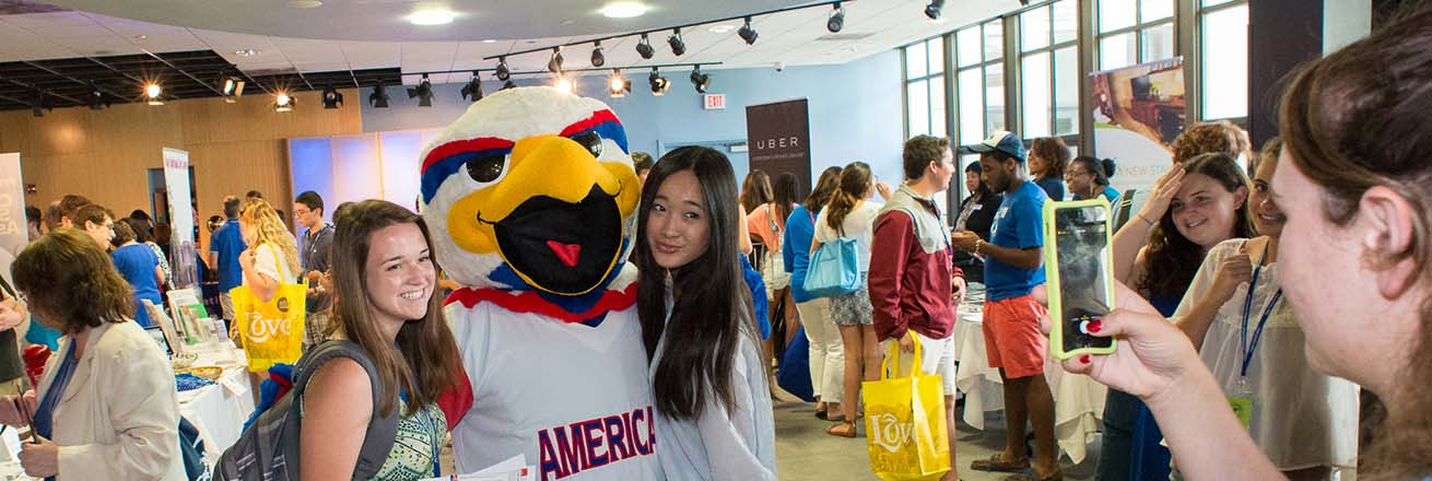 Clawed the Eagle poses with students