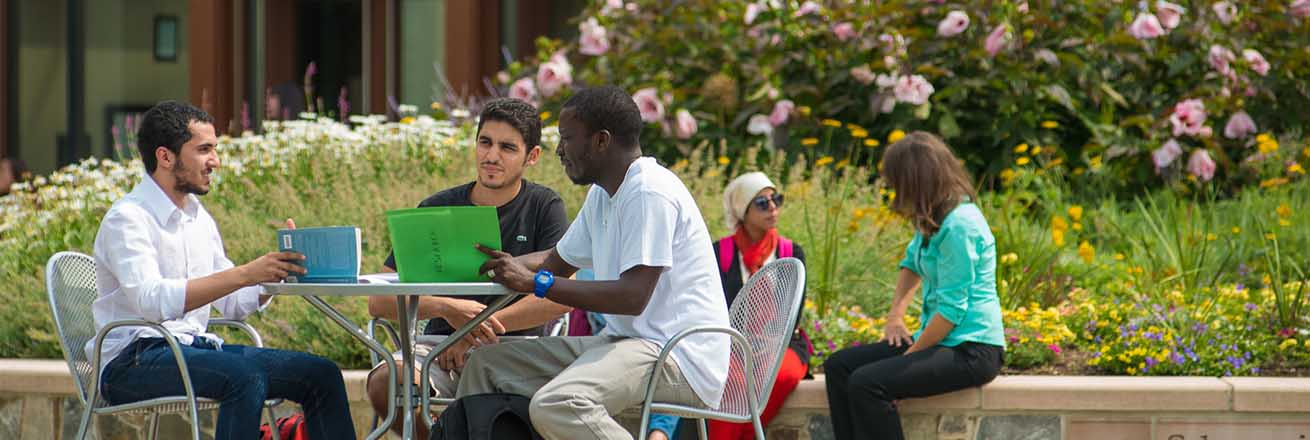 Students enjoying the Quad outside the School of International Service building