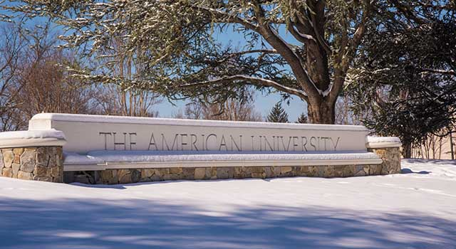 The American University gate covered in snow.