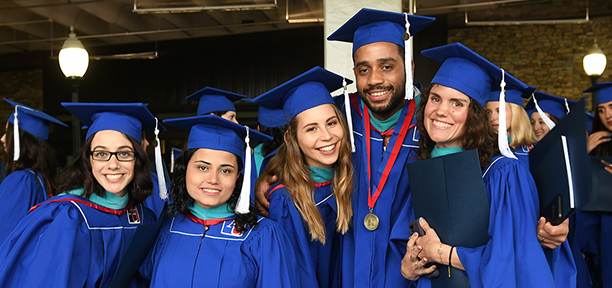 Members of the class of 2019 gather in the tunnel for commencement