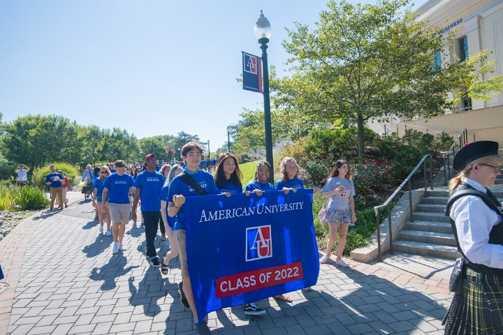 Class of 2022 members hold banner during convocation