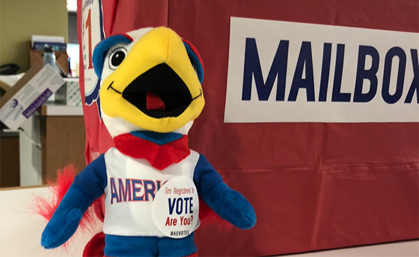 Clawed stuffed toy and absentee ballot mailbox