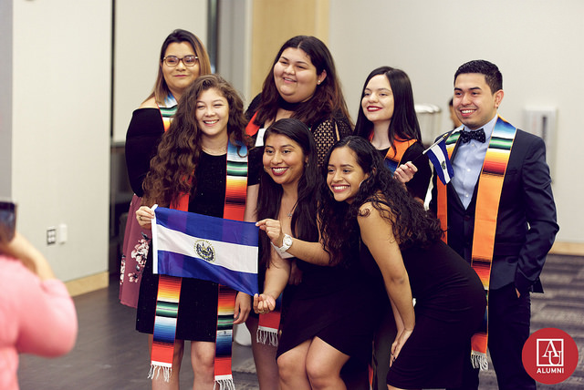 A group of students pose together after participating in the 2018 Latinx Gradution