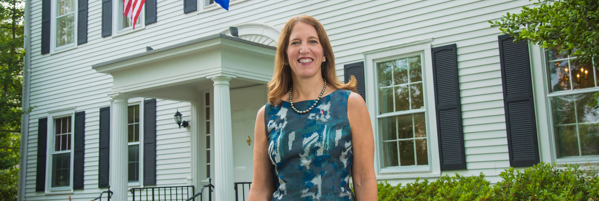 President Burwell in front of the President's Office Building