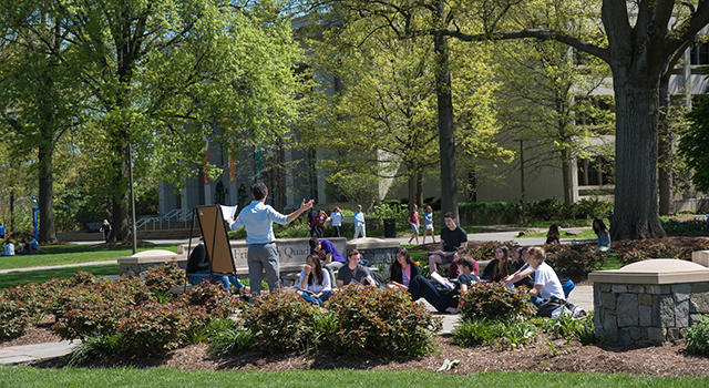 Faculty teaches on the main quad of American University