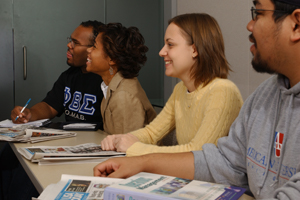 Four Washington Semester Program students sitting in class