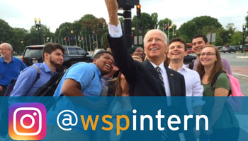 Former Vice President Joe Biden taking a selfie in front of the Newseum with Washington Semester Students