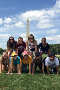 Alyssa with students in front of the Washington Monument