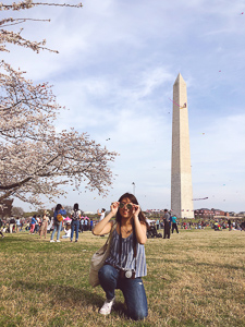 Hyeseung on the National Mall while the cherry blossoms are in bloom