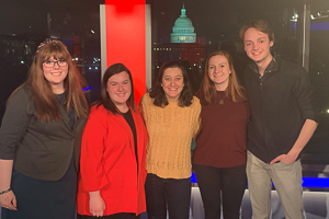 Emily with friends on the set of Tucker Carlson