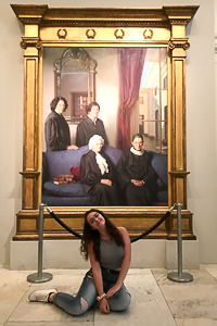 Jessica poses next to a painting at the National Portrait Gallery