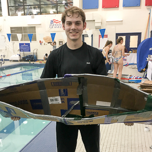 Washington Semester Program student Wes Nichols competing in a boat building race at the American University Wilson Aquatic Center