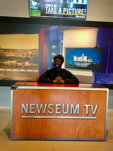 Antonia posing at the Newseum broadcast studio section