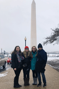 Molly with friends in front of Washington Monument