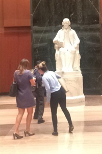 Noelle and friends visiting a famous statue in the Capitol building