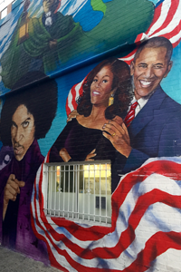 Mural of the Obamas and Prince with the American flag