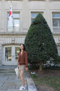 Jiyoun standing in front of the South Korean Embassy