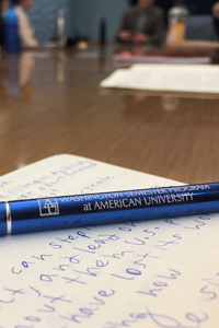 Sarah's notes and a pen with Washington Semester Program written across it