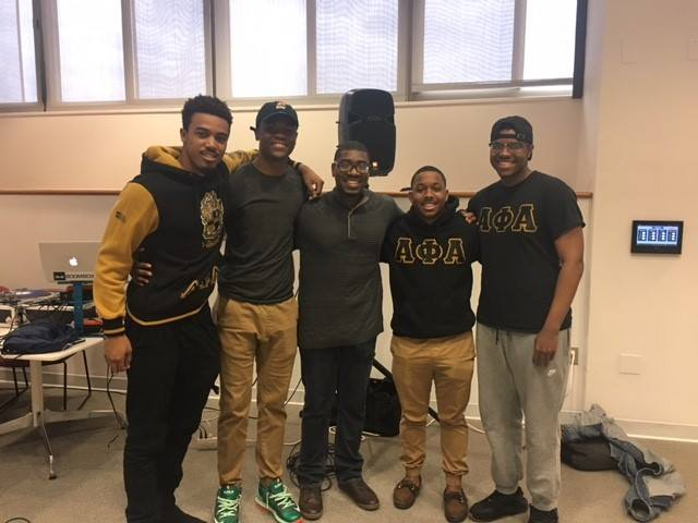 Four Alpha Phi Alpha members with Kai Roberts, a Grad Studies event speaker