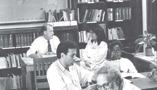 Students and faculty study at various tables and chairs in the Davenport Lounge in 1980