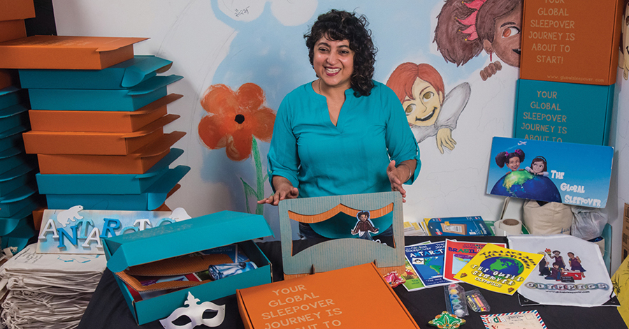 Geeta Raj surrounded by children's books